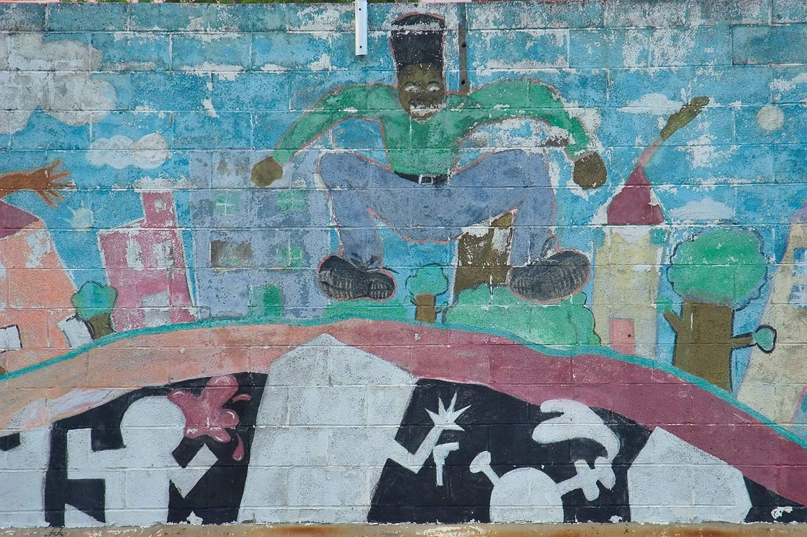 A jumping person on a mural on a wall of Kingsley...District. New Orleans, Louisiana