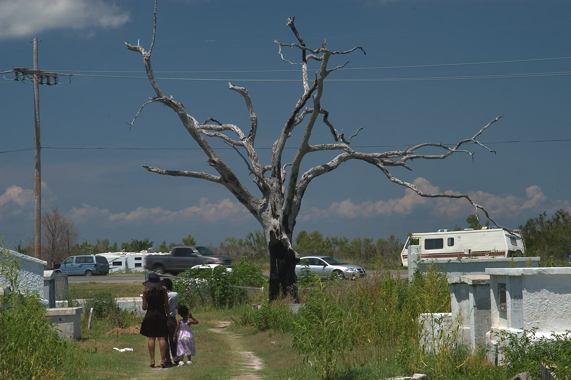 Visitors of a cemetery in Verret near Rd. 46 in...East from New Orleans, Louisiana