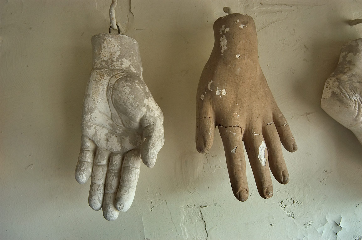 Plaster replications of hands in a niche...Roch Cemetery. New Orleans, Louisiana
