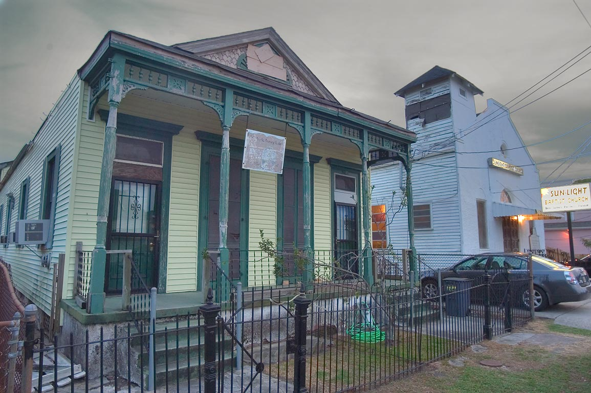 A shotgun house and Sun-light Baptist Church on...St. in Uptown. New Orleans, Louisiana