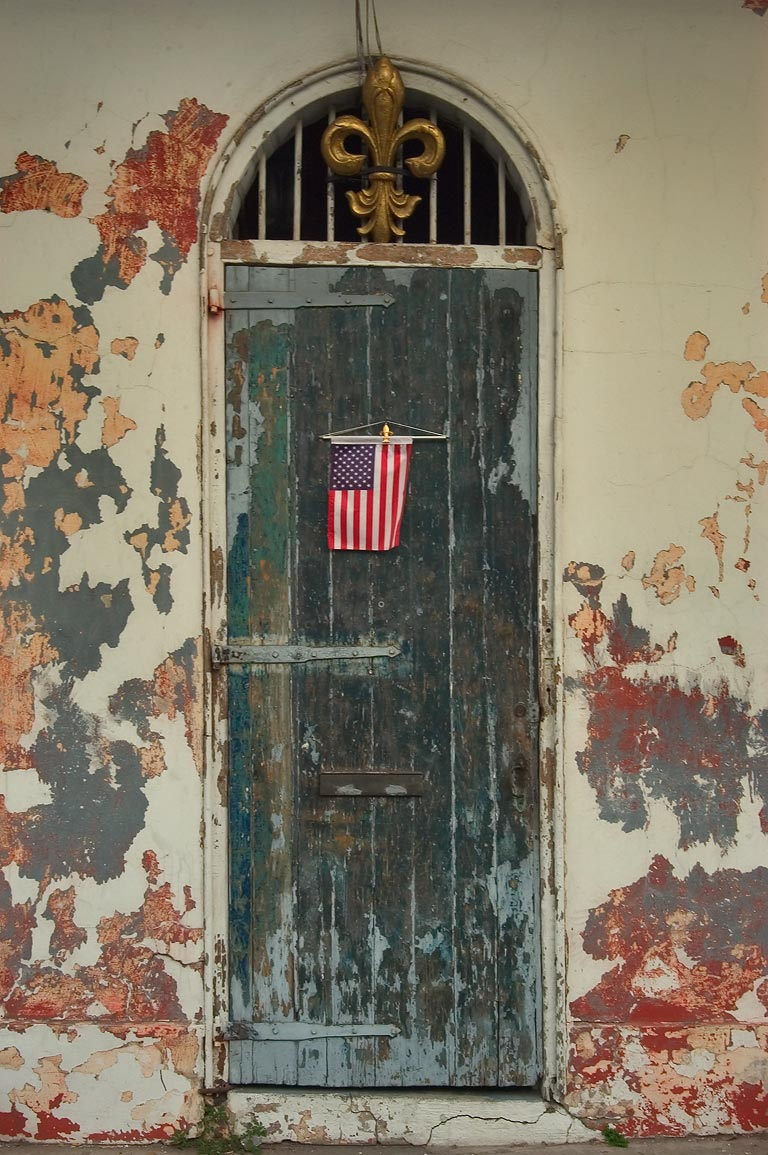 An American flag on a door at Dauphine St. near...French Quarter. New Orleans, Louisiana