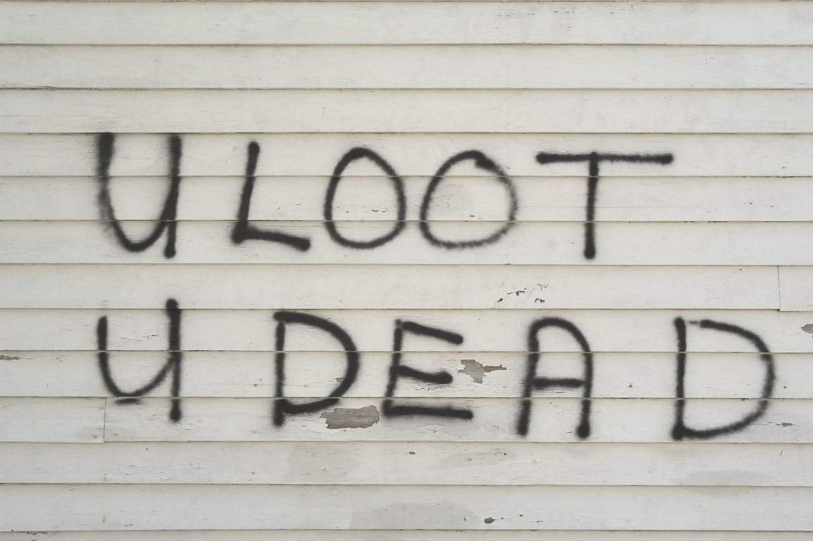 "A warning ""U Loot U Dead"" on a side of a house at...St. in Bywater. New Orleans, Louisiana"