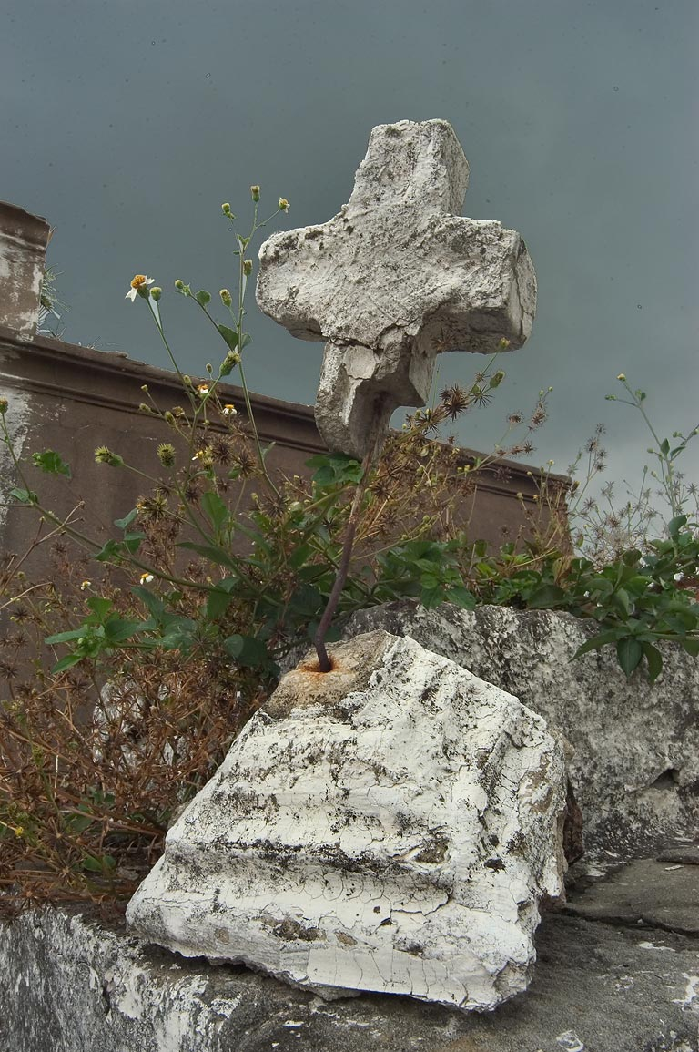 A broken cross on a tomb in St.Louis Cemetery No. 2. New Orleans, Louisiana
