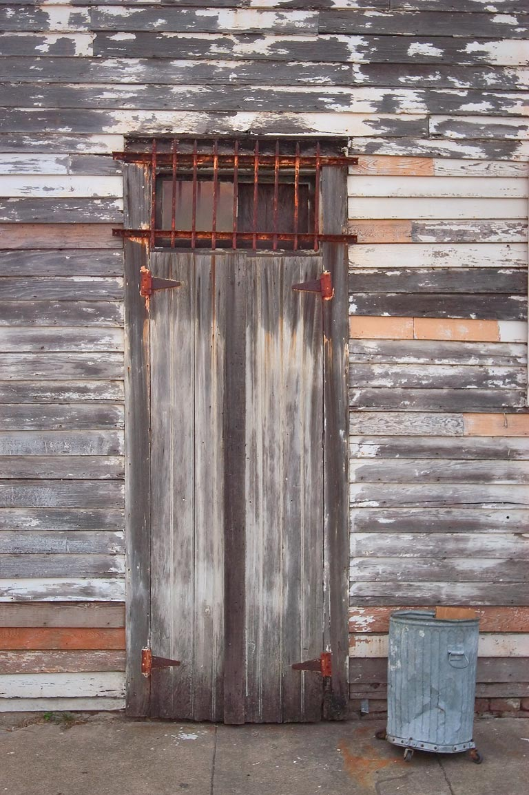 A weathered door at 3929 Royal St. near Bartholomew St. in Bywater. New Orleans, Louisiana