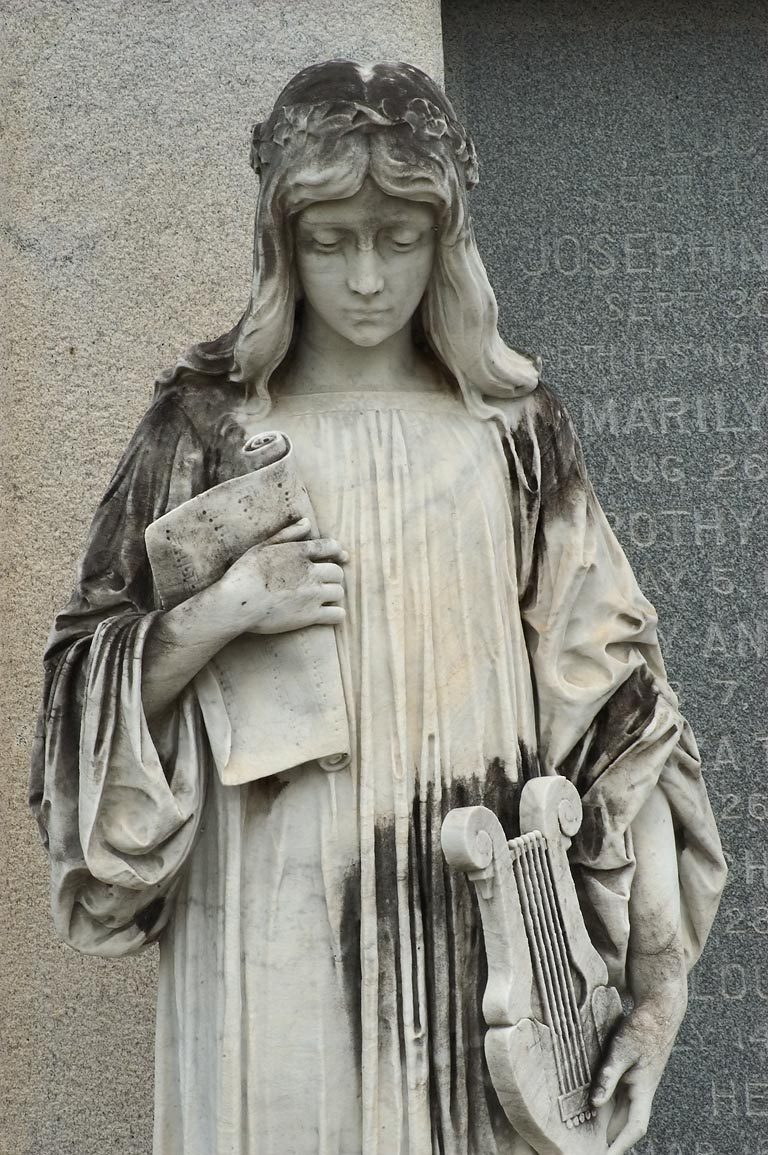 A woman with a harp on a family tomb of Lucien...Cemetery. New Orleans, Louisiana
