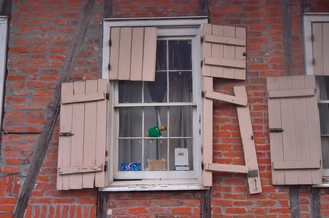 A window of a red brick house on Port St., a...St. in Bywater. New Orleans, Louisiana