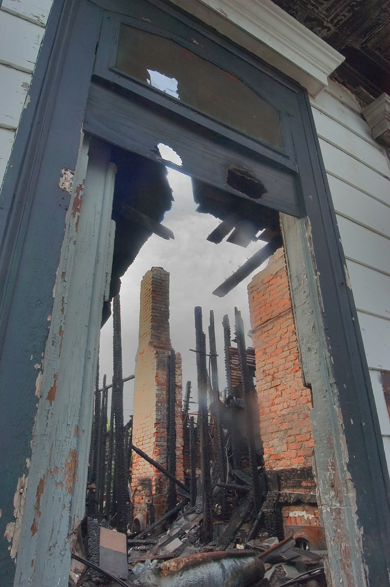 A doorway of a shotgun house damaged by fire at...Marigny. New Orleans, Louisiana
