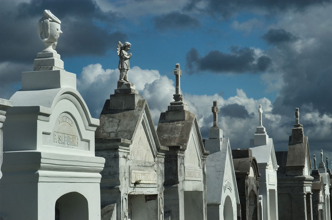 Crosses and figures on tops of tombs in St.Louis Cemetery No. 3. New Orleans, Louisiana