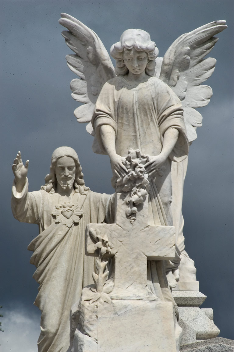 "A saint ""catching"" a busy angel on a tomb of...Cemetery No. 3. New Orleans, Louisiana"