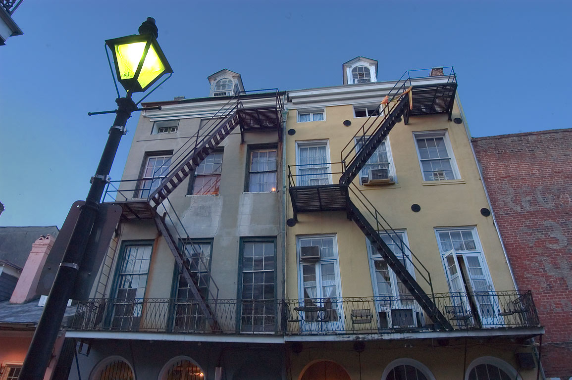 A lamppost and fire stairs at 717 Toulouse St. in French Quarter. New Orleans, Louisiana