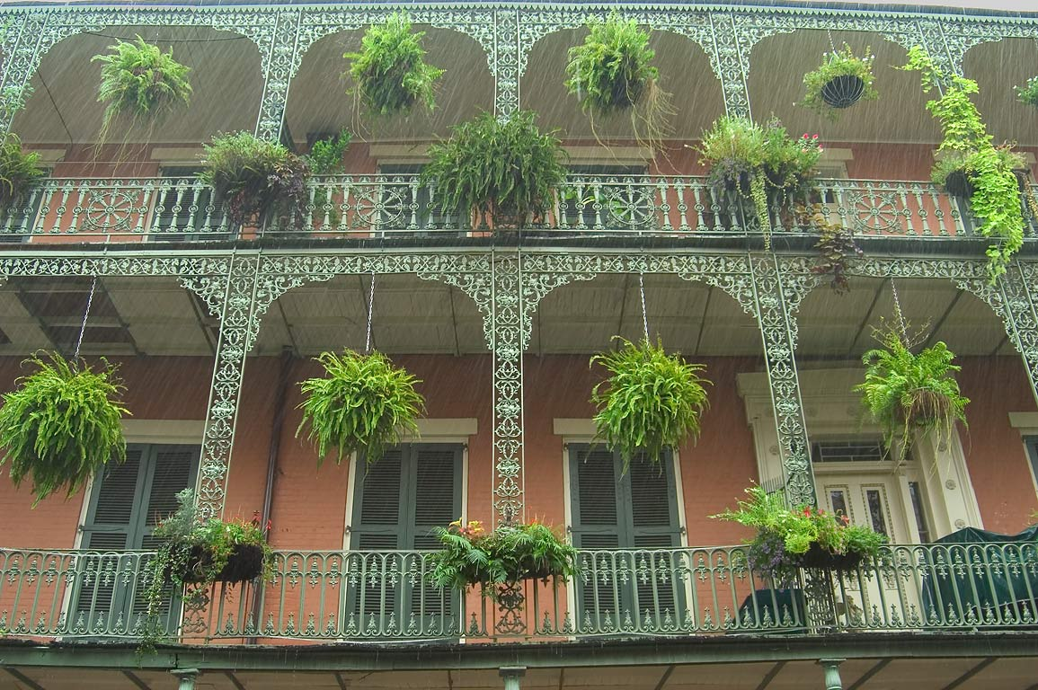 Iron wrought balconies at a corner of St.Philip...at rain. New Orleans, Louisiana