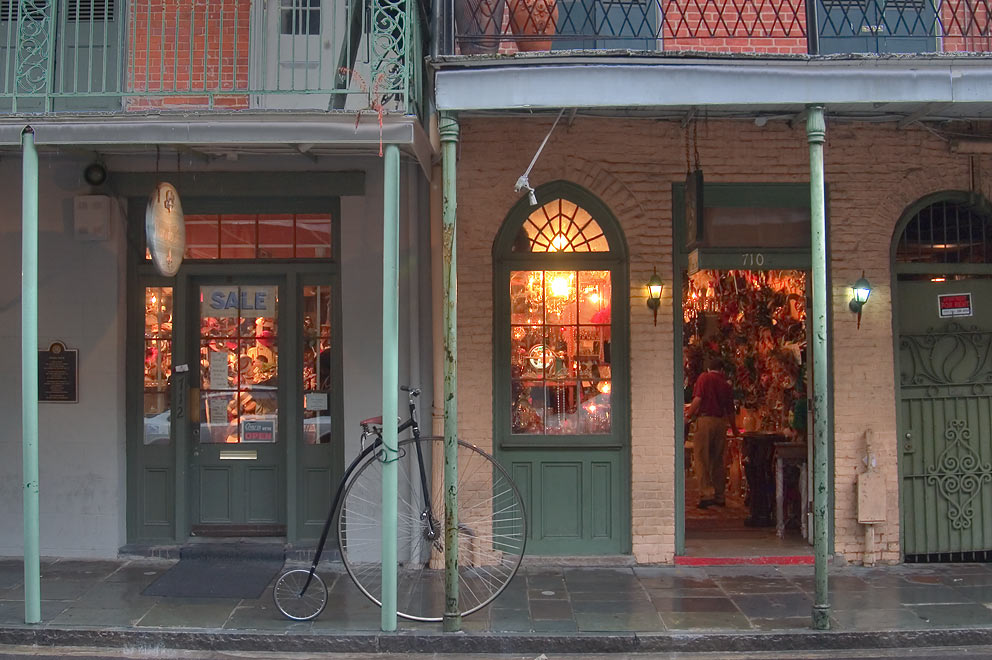 Souvenir shops and an antique bicycle at 710...at rain. New Orleans, Louisiana