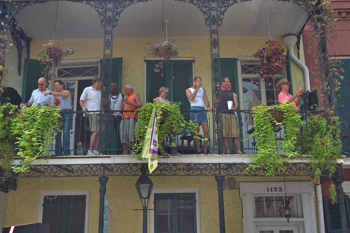 People on a balcony at 1123 Royal St. watching...French Quarter. New Orleans, Louisiana