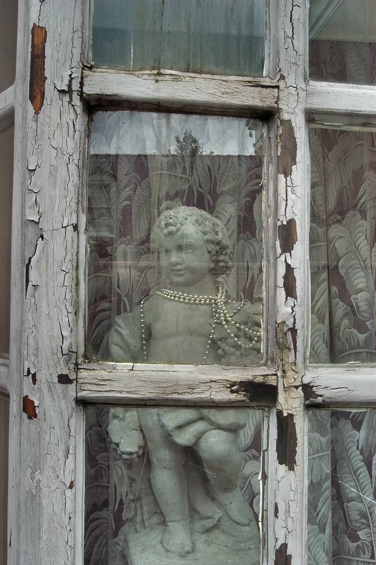 A window at 627 Ursulines St. near Royal St. in French Quarter. New Orleans, Louisiana