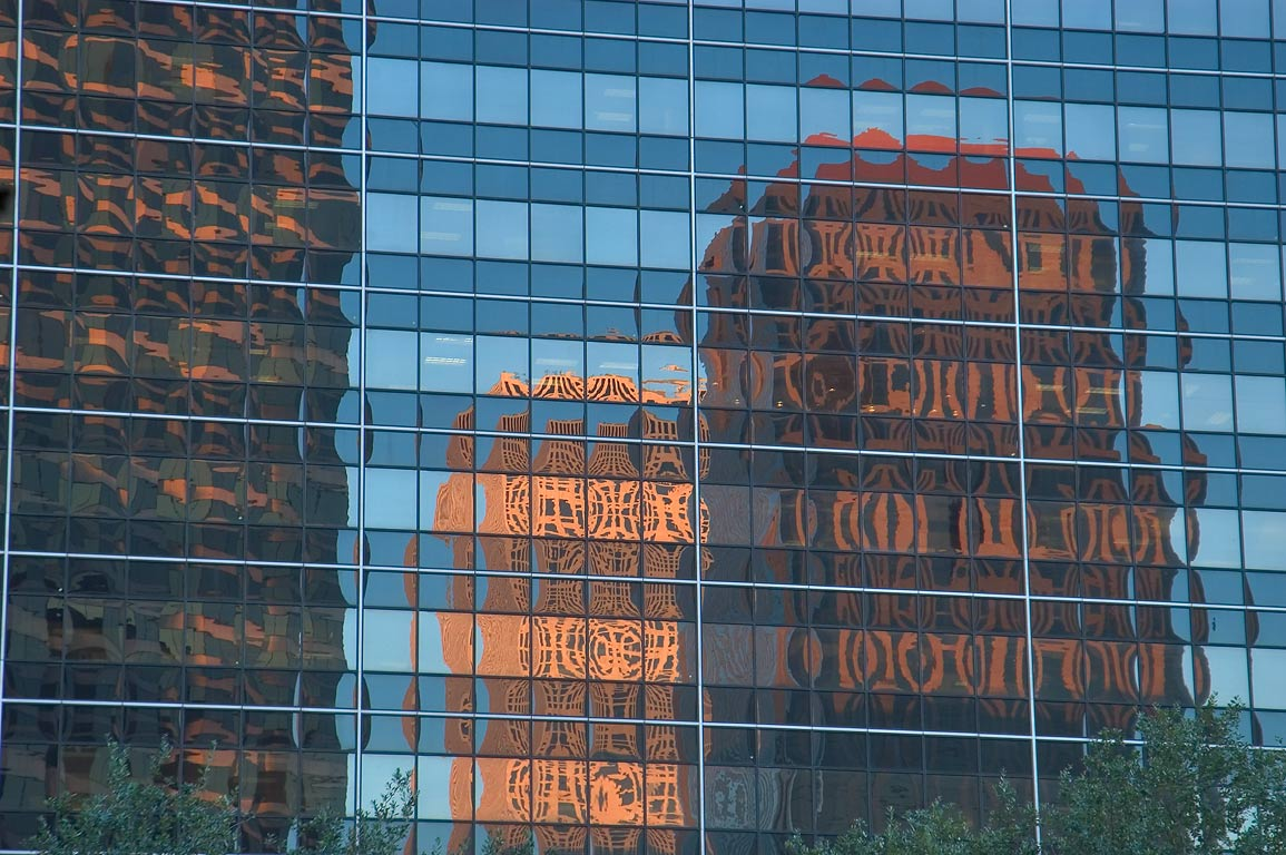 Reflections in high-rise buildings on Loyola Ave...District. New Orleans, Louisiana