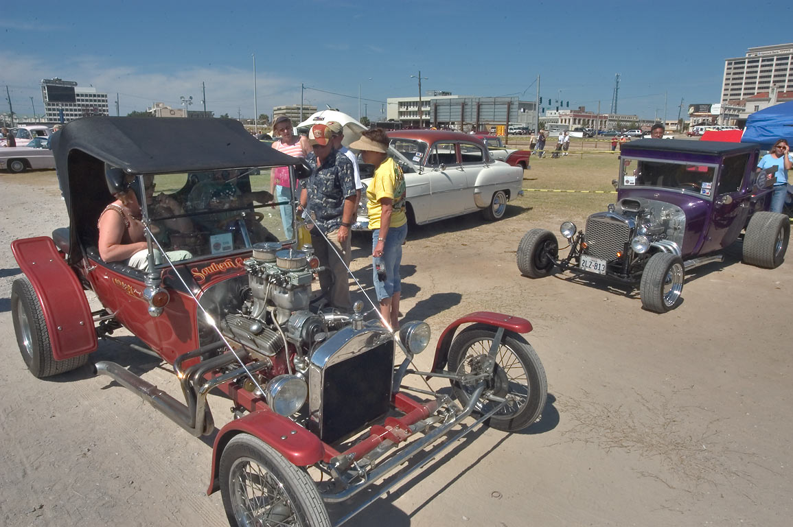 "Spectators and auto enthusiasts at ""Cruisin' The...vintage cars. Gulfport, Mississippi"