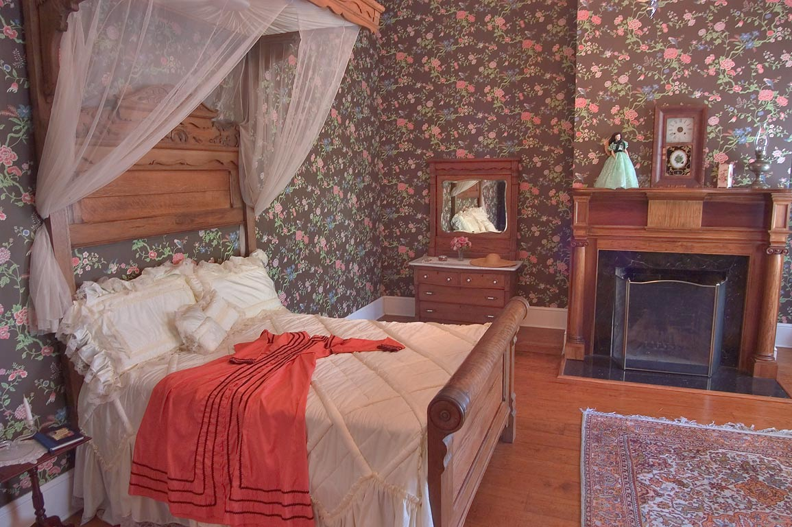 A bedroom with wallpaper in Greenwood Plantation. St.Francisville, Louisiana
