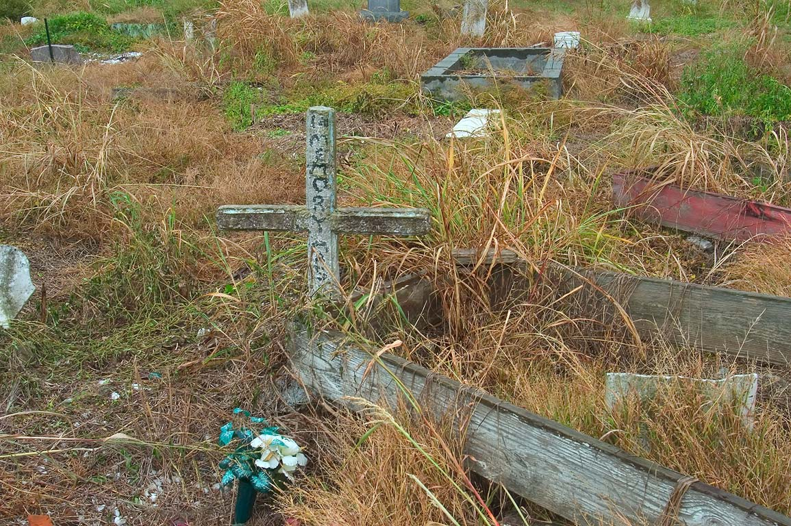 A cross and tombs in Holt Cemetery. New Orleans, Louisiana
