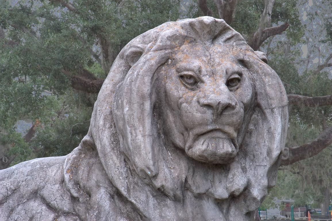 A concrete lion on Peristyle in City Park. New Orleans, Louisiana