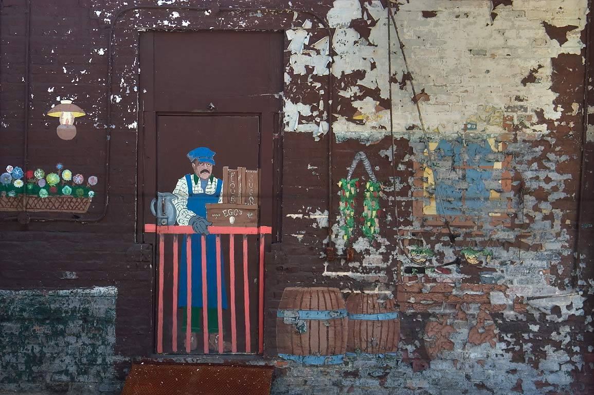 Inmate murals decorating a transformed former...Gravier St.. New Orleans, Louisiana