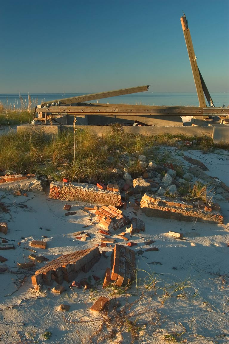 Rubble of Ship Island Lighthouse at sunset. Mississippi