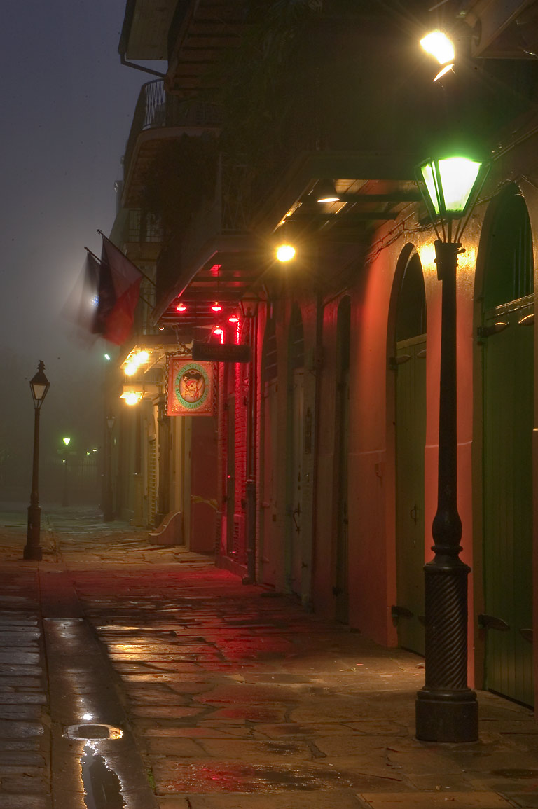 Pirate's Alley from a corner of Cabildo Alley...in mist. New Orleans, Louisiana