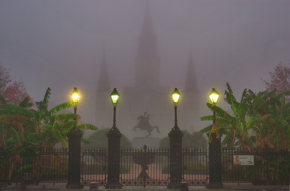 Jackson Square from Decatur St. gate in French...morning fog. New Orleans, Louisiana