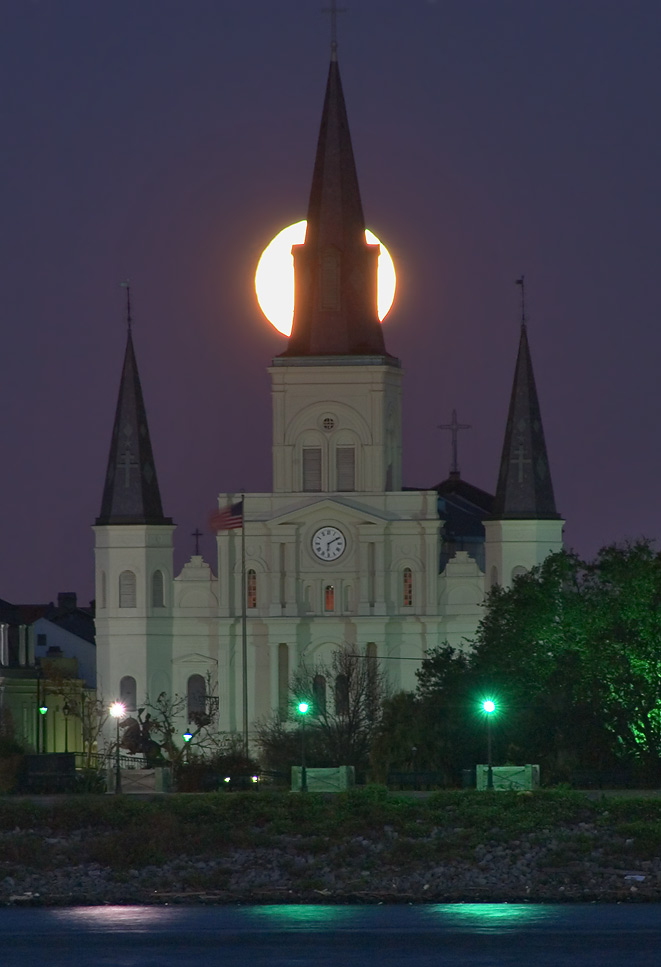 Moonset behind St.Louis Cathedral, view from a levee in Algiers. New Orleans, Louisiana