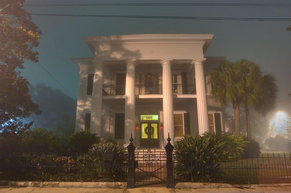 Pritchard-Pigott house at 1407 First St. in Garden District in fog. New Orleans, Louisiana
