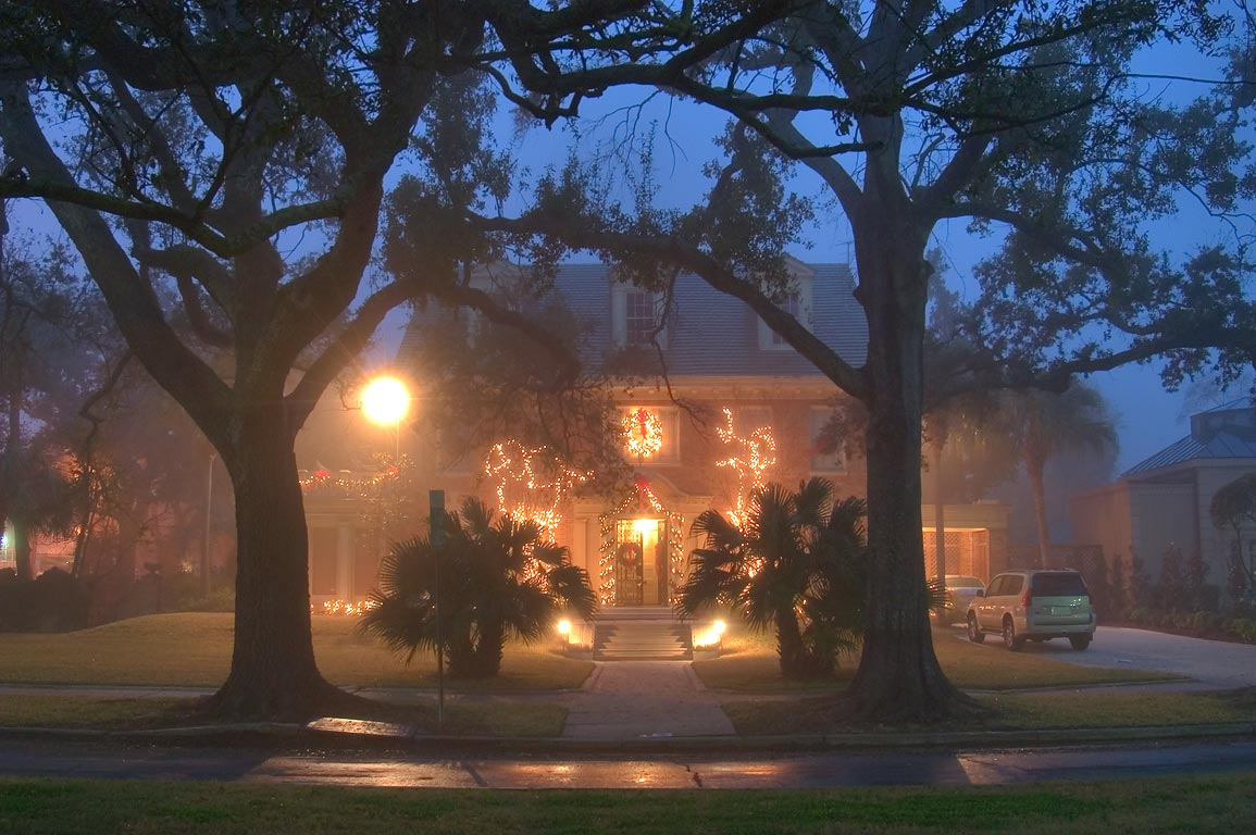Christmas decorations on Harry Swift-Barranger...Blvd. in fog. New Orleans, Louisiana