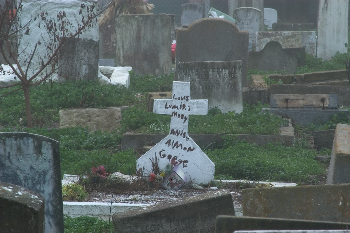 A cross and tombs in negro section of Carrollton...at morning. New Orleans, Louisiana