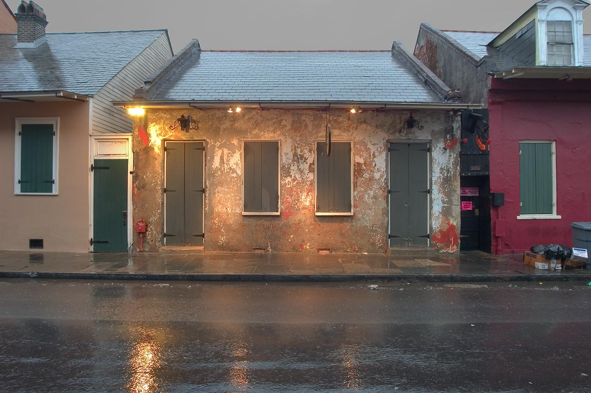 A Creole cottage at 732-738 Toulouse St. near...at rain. New Orleans, Louisiana
