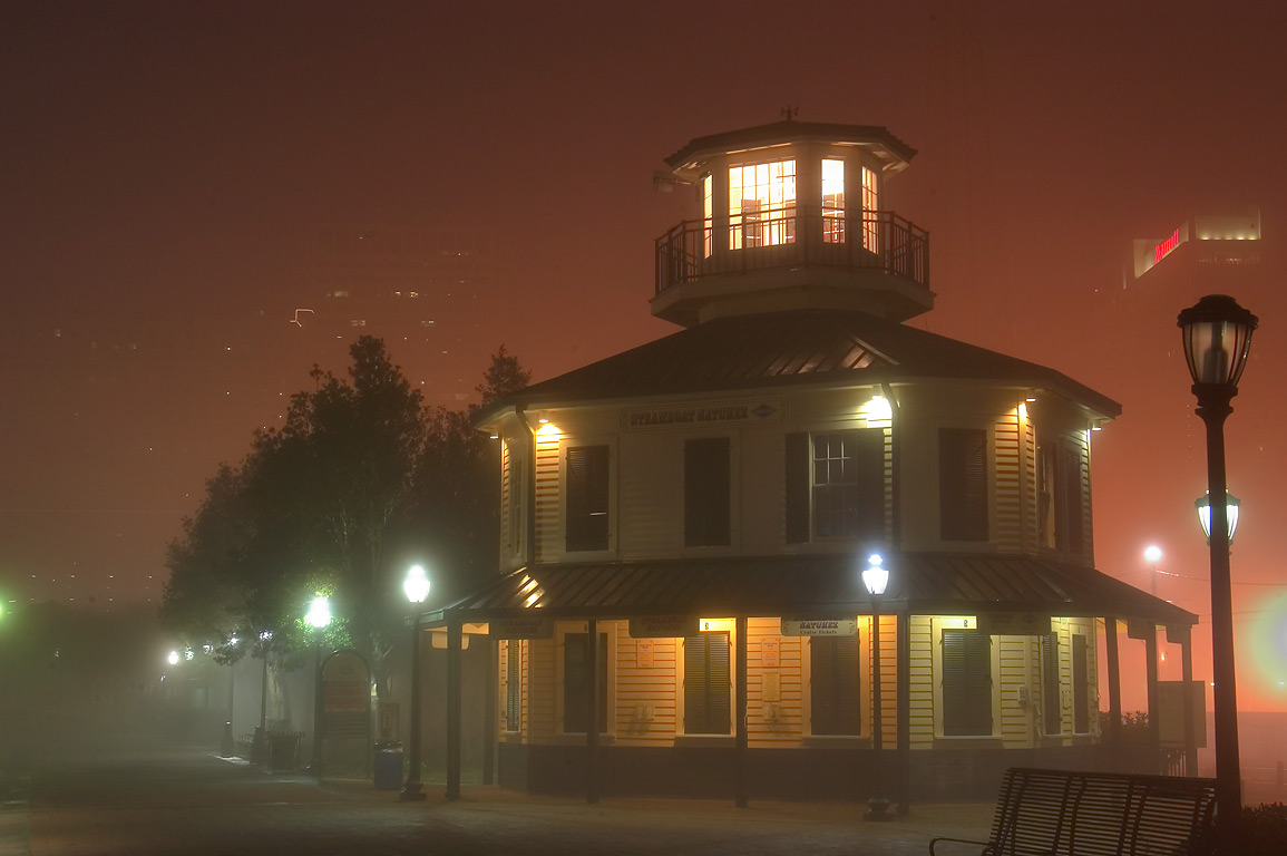 Cruise tickets office of Natchez Steamboat at morning in fog. New Orleans, Louisiana