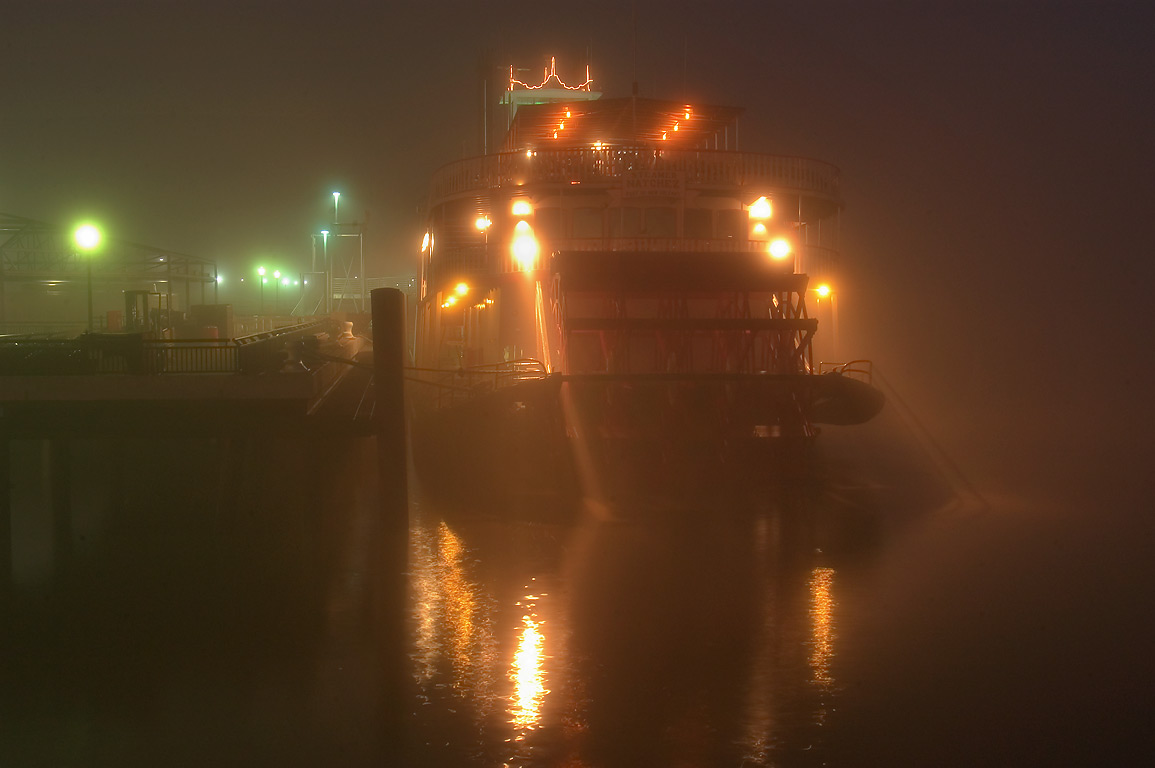 Natchez Steamboat at morning in fog, view from back side. New Orleans, Louisiana
