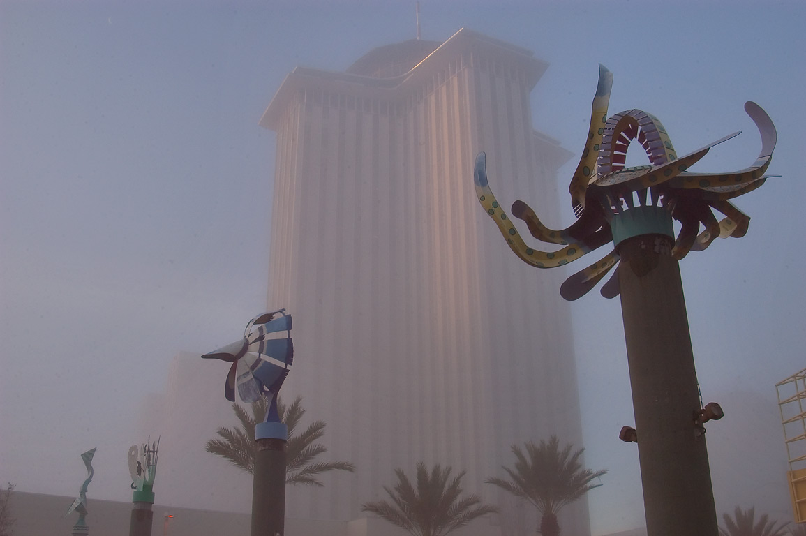 Sculptures in front of Aquarium of the Americas...in morning fog. New Orleans, Louisiana
