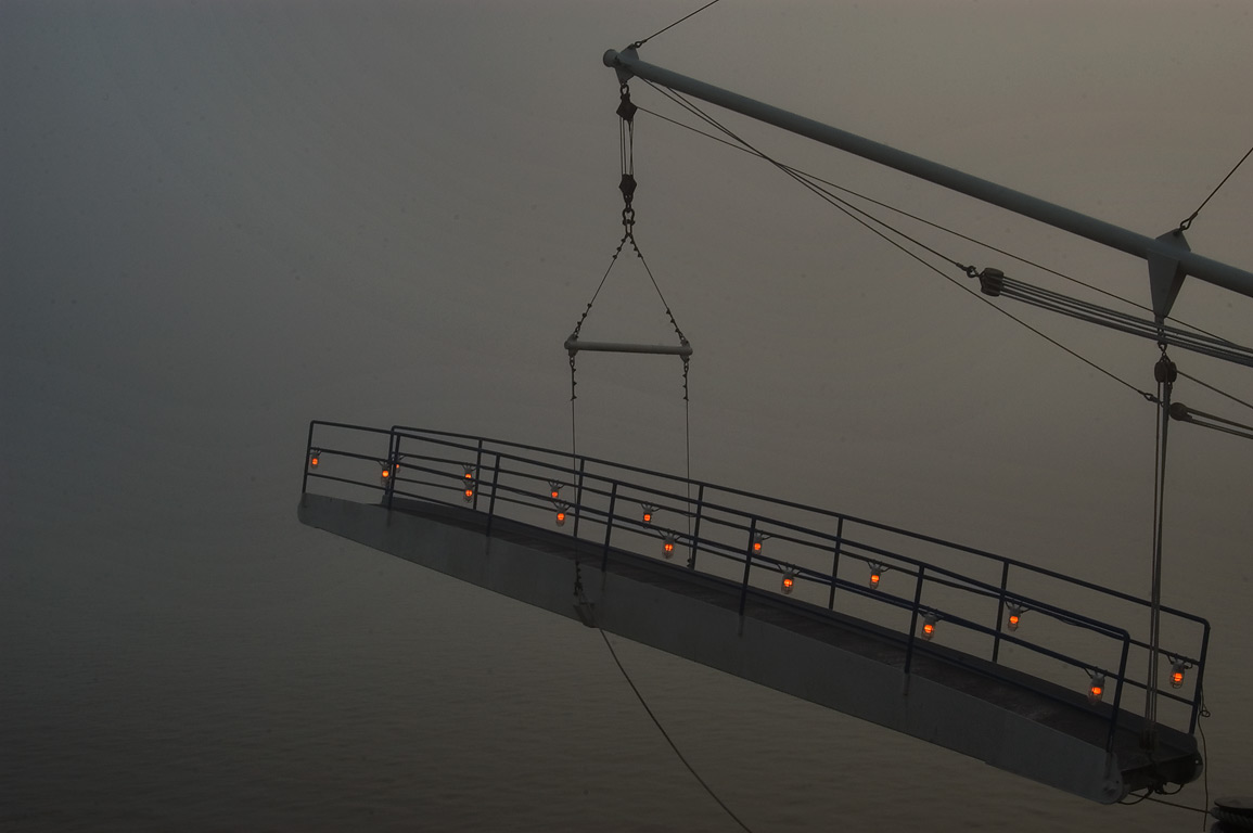 Overhanging stairs of Natchez Steamboat in fog. New Orleans, Louisiana