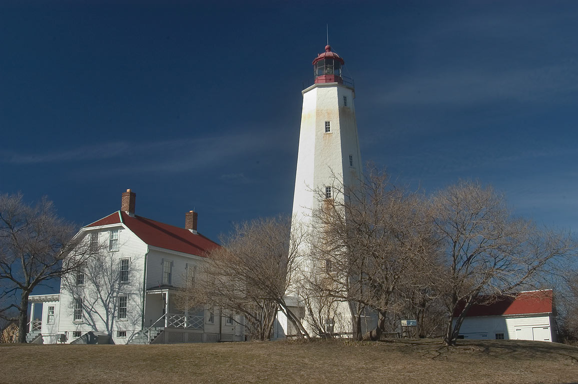 Keepers quarters and Sandy Hook Lighthouse, view from Hudson Dr.. Sandy Hook, New Jersey