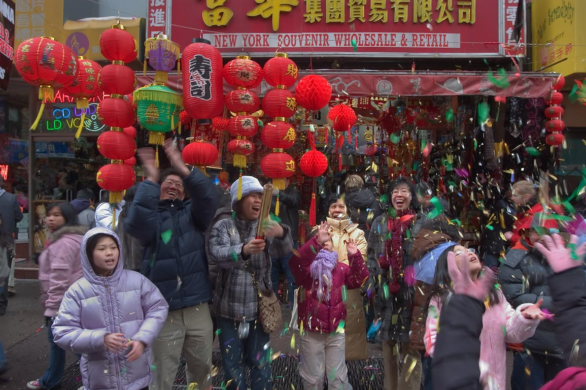 Families celebrating Chinese New Year near Mulberry St.. New York City