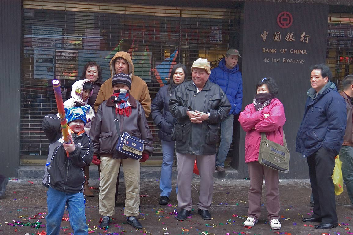 A family celebrating New Year at 42 East Broadway...Bowery St. in Chinatown. New York City