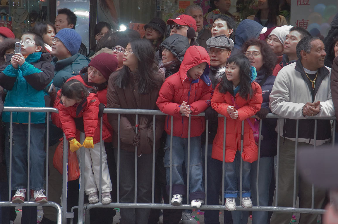 Spectators at Chinese Lunar New Year Parade on Mott Street in Chinatown. New York City