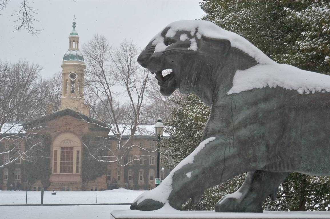 A tiger behind Whig Hall, with Nassau Hall in...University. Princeton, New Jersey