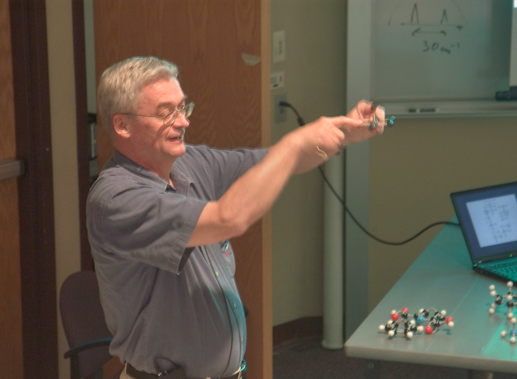 "A lecture of J. Laane, ""Applications of Symmetry...at a physics workshop. Casper, Wyoming"