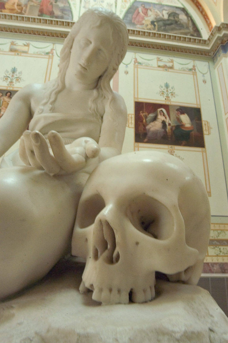 Marble statue of a woman with a skull in Hermitage museum. St.Petersburg, Russia