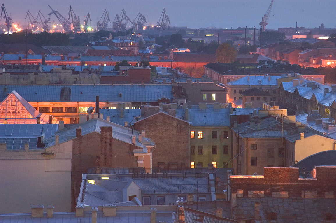 Sea Port on horizon from colonnade of St.Isaac Cathedral at evening. St.Petersburg, Russia