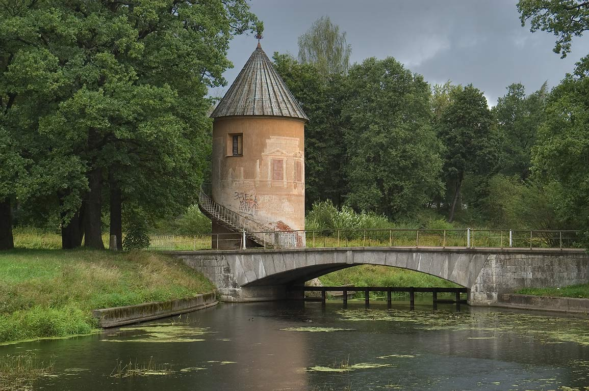 Pil Tower and a bridge of Slavianka River. Pavlovsk, a suburb of St.Petersburg, Russia