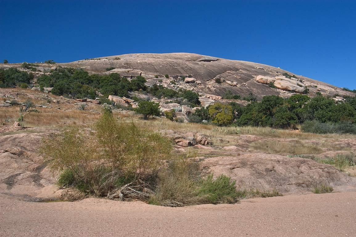 Enchanted Rock behind Sandy Creek from Loop Trail. Fredericksburg, Texas