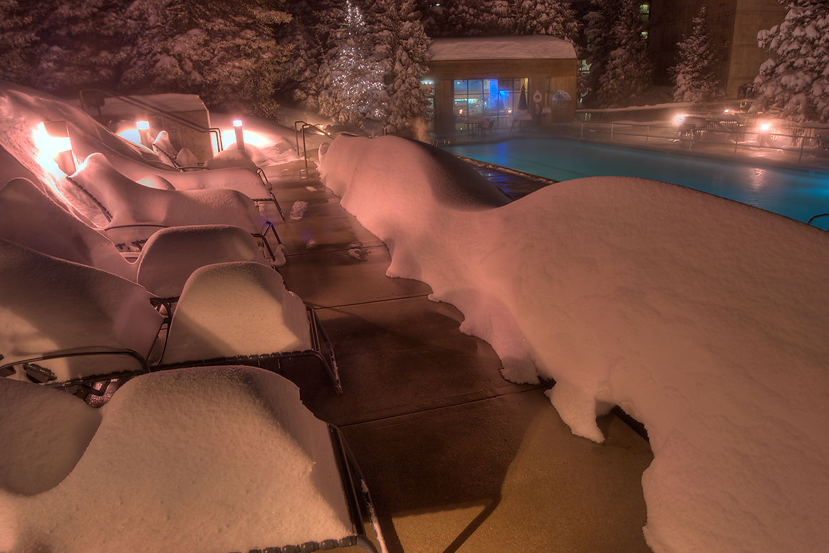 Tanning beds in snow near a swimming pool of Cliff Lodge in Snowbird Ski Area. Utah