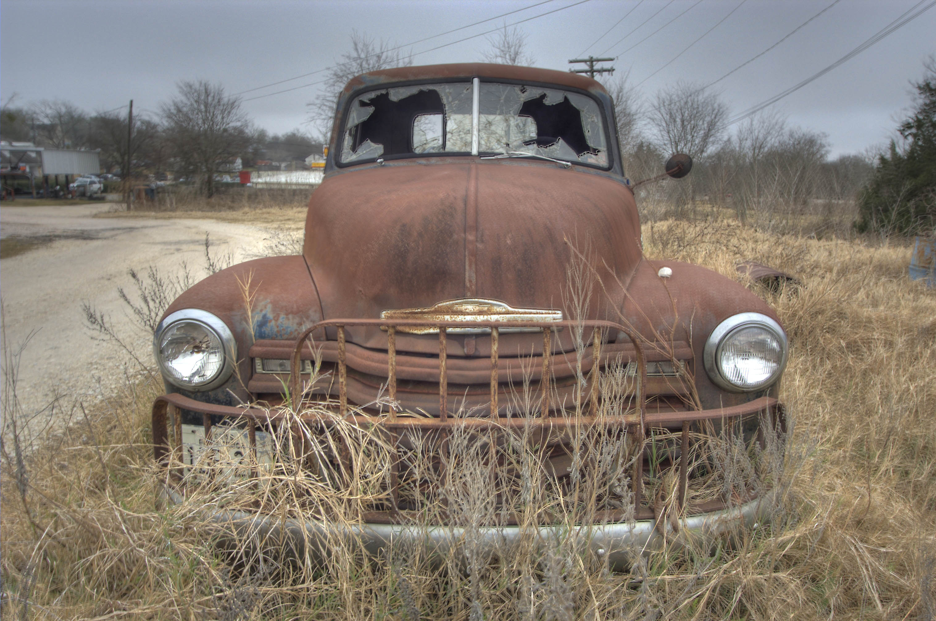 Photo 613-22: Rusty car on Houston St.. Anderson, Texas