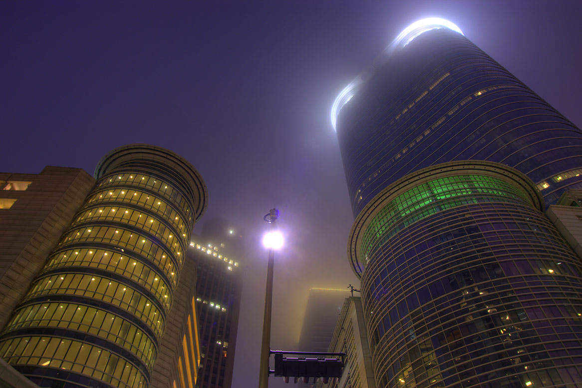 Towers at a corner of Smith and Bell streets at morning in fog. Houston, Texas