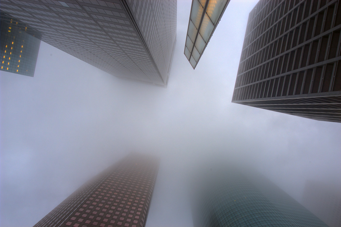 Looking up from a corner of Louisiana and Lamar streets in fog. Houston, Texas
